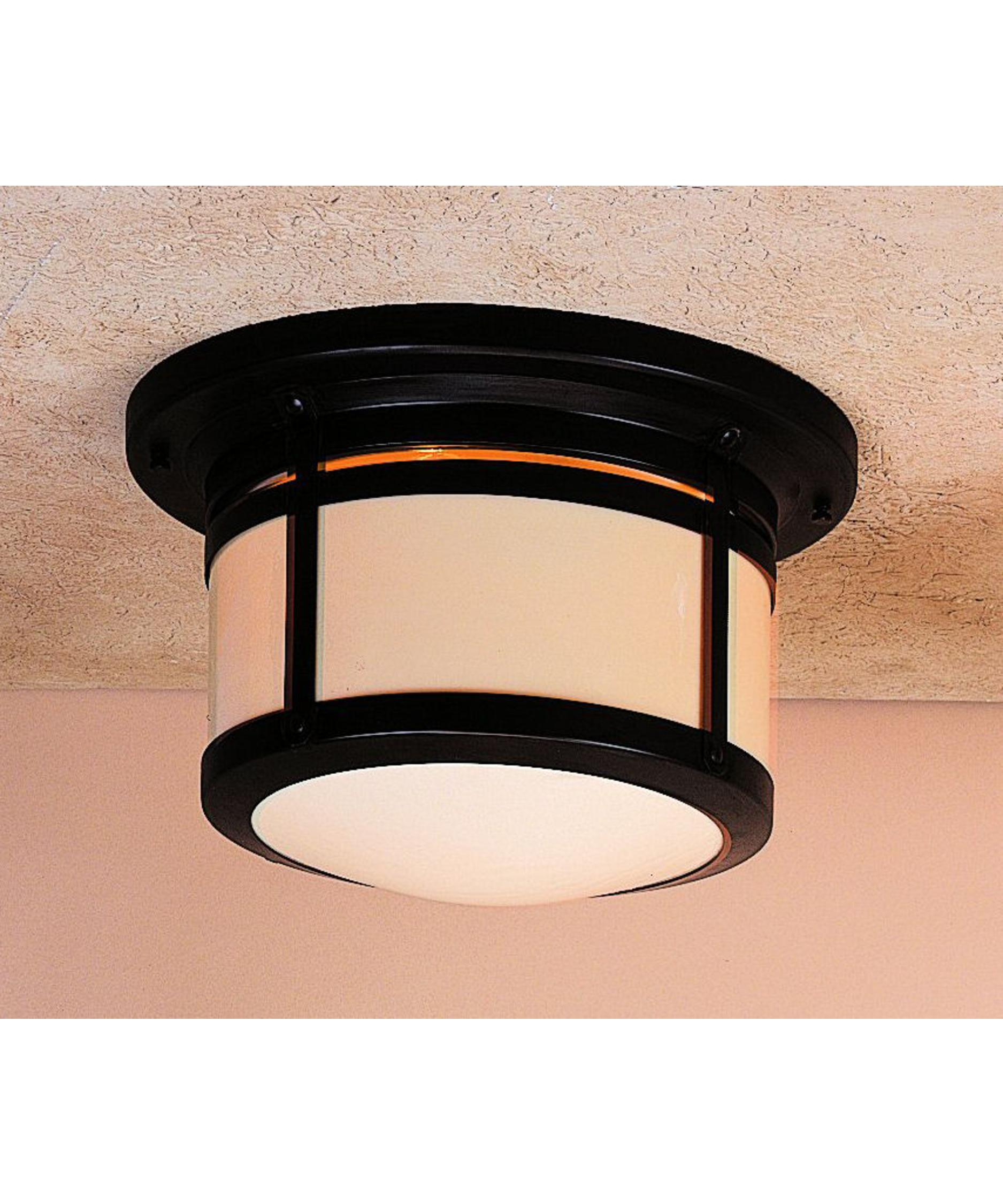 shown in bronze finish with cream glass arroyo craftsman lighting