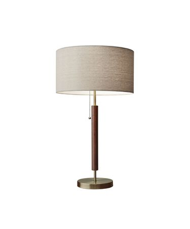 Shown in Walnut-Antique Brass finish and Natural Linen shade
