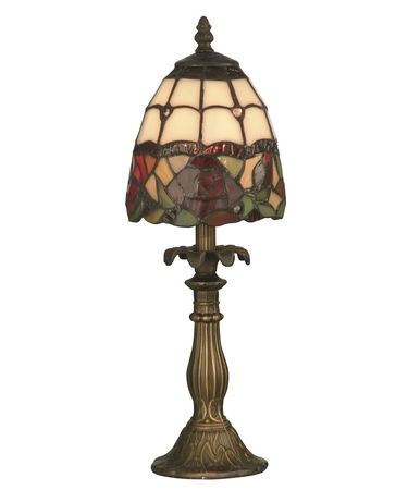 Shown in Antique Brass finish and Tiffany shade