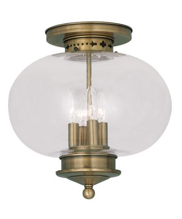 Shown in Antique Brass finish and Hand Blown Clear glass