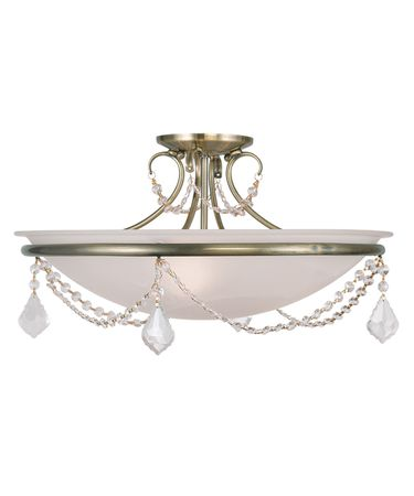 Shown in Antique Brass finish, Clear crystal and White Alabaster glass